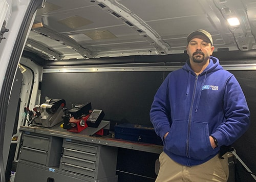 Owner, Mike Dussault inside his locksmith truck.